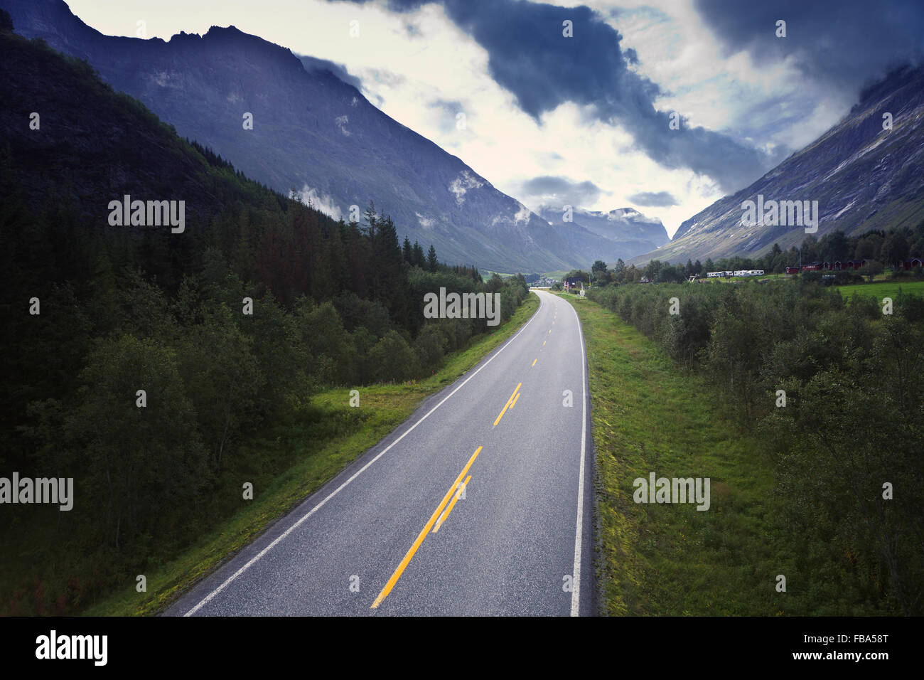 Norway, More og Romsdal, Sunnmore, View along road leading through mountain valley - Stock Image