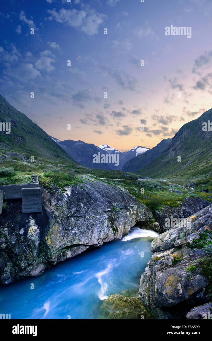Norway, More og Romsdal, Sunnmore, Geirangerfjord, Stream with rocky shores in mountain valley Stock Photo