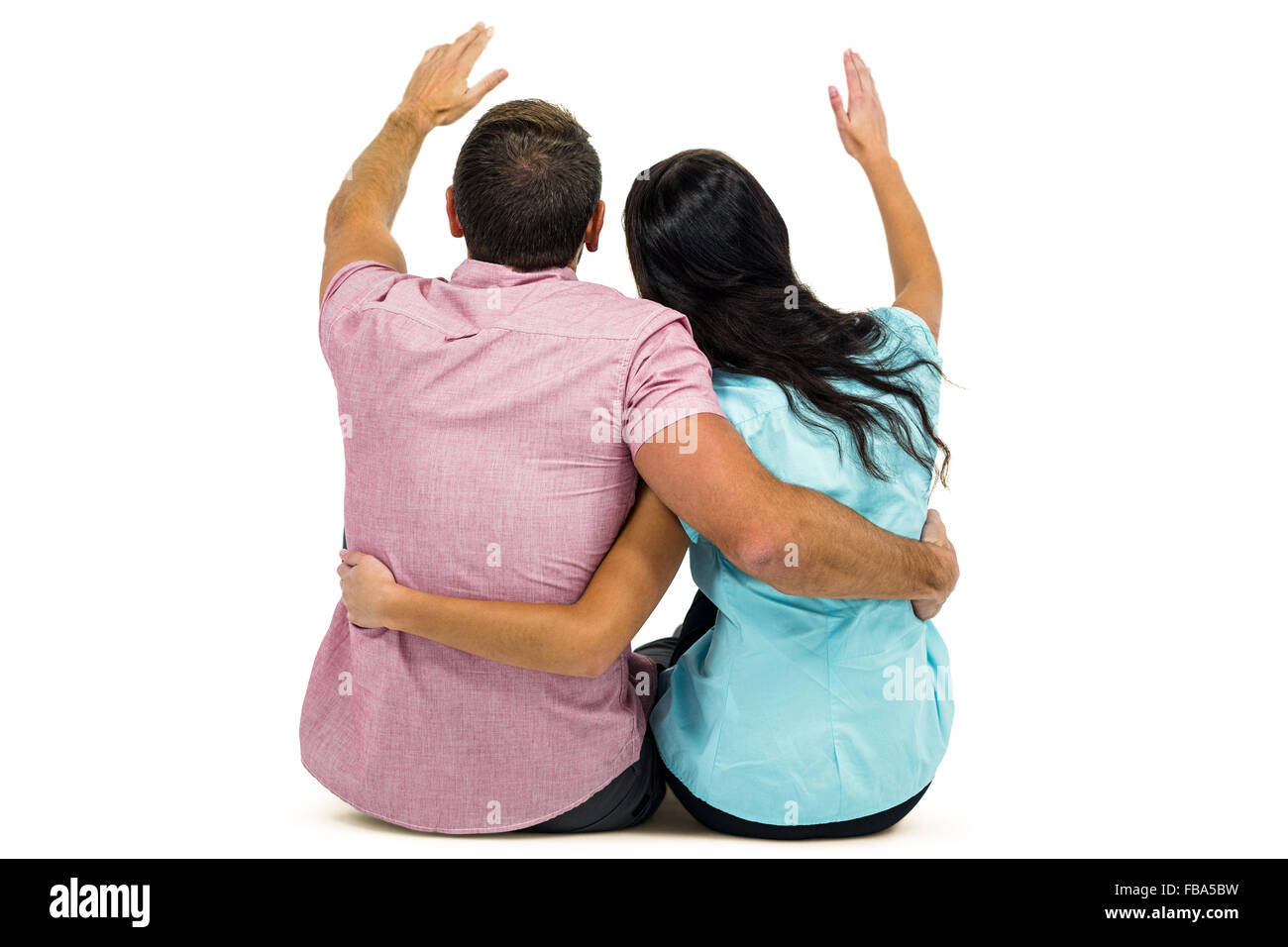 Rear view of couple with arm around - Stock Image