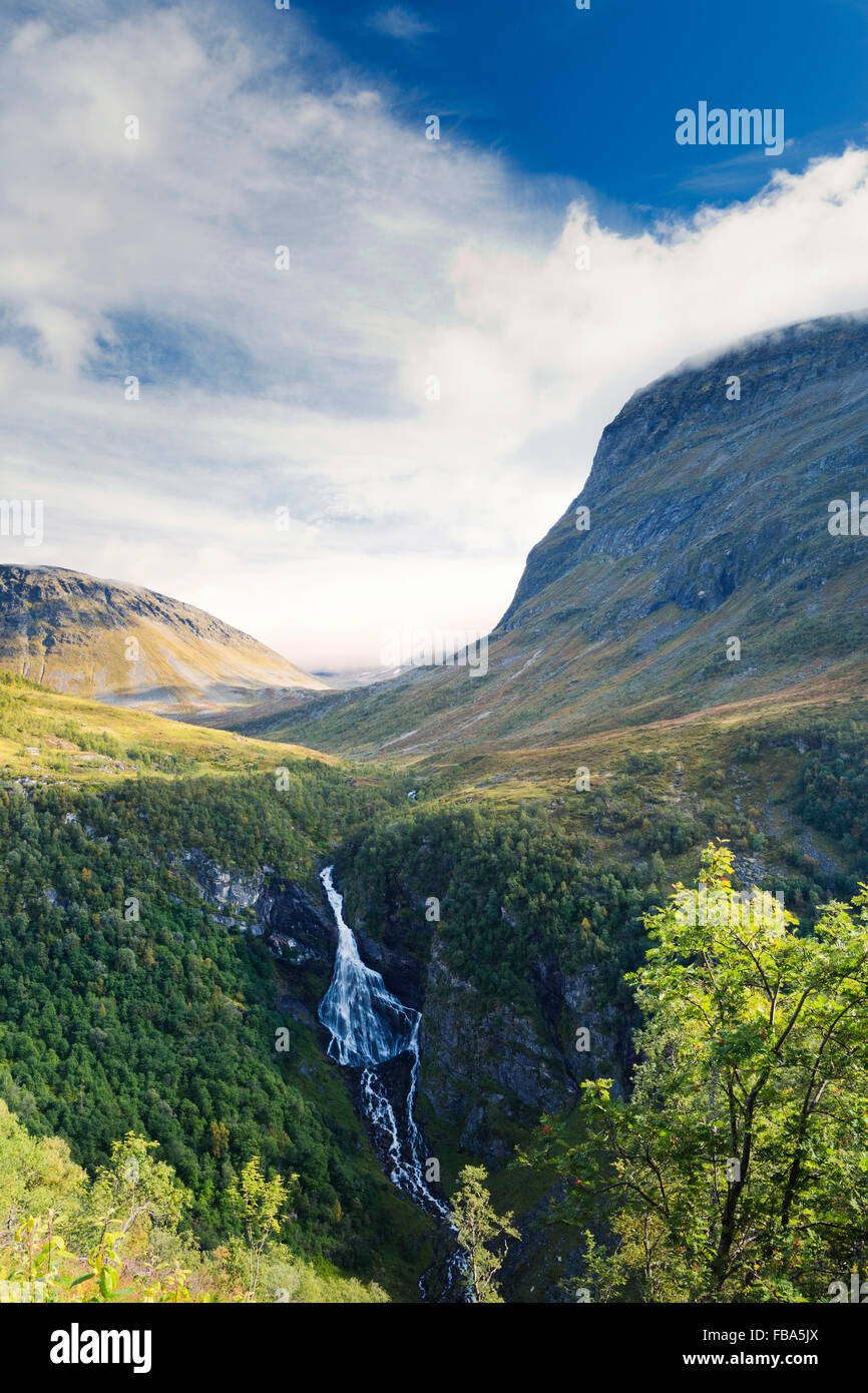 Norway, More og Romsdal, Sunnmore, View of waterfall in mountains - Stock Image