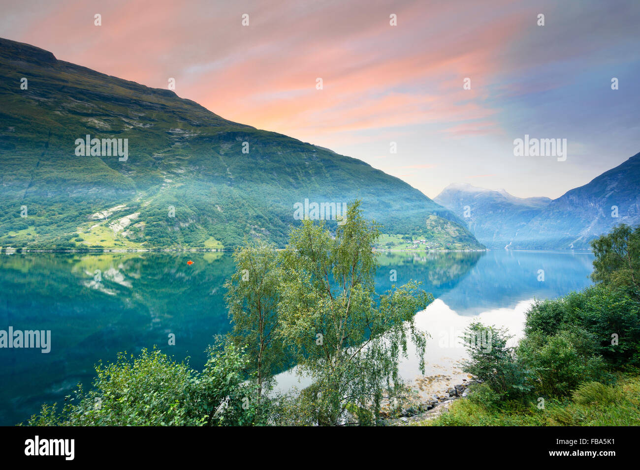 Norway, More og Romsdal, Sunnmore, View of lake in mountains at sunrise - Stock Image