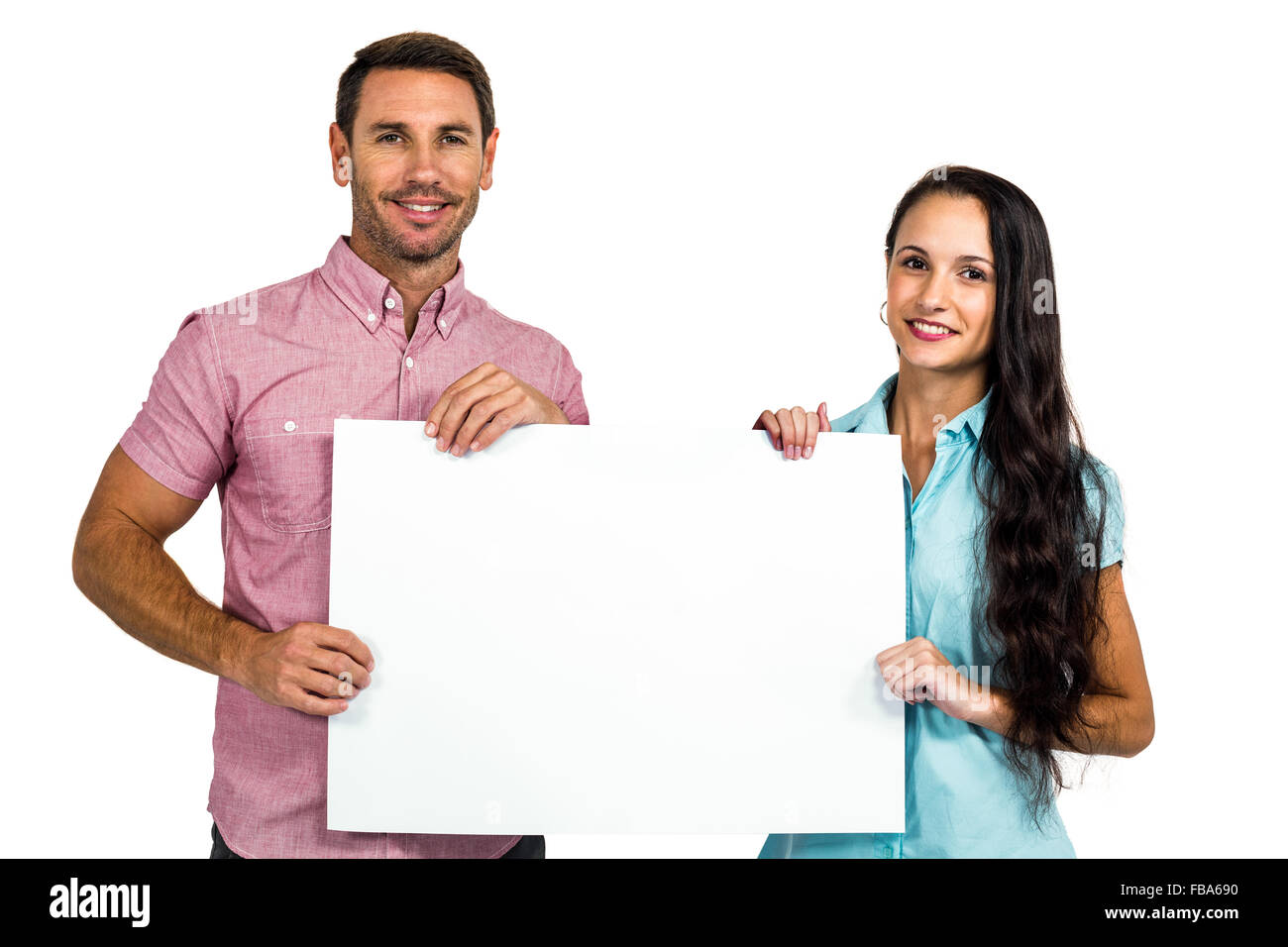 Smiling couple showing blank sheet - Stock Image