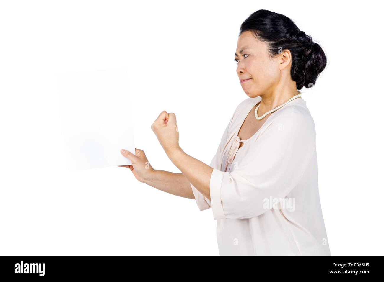 Angry woman shaking her fist - Stock Image