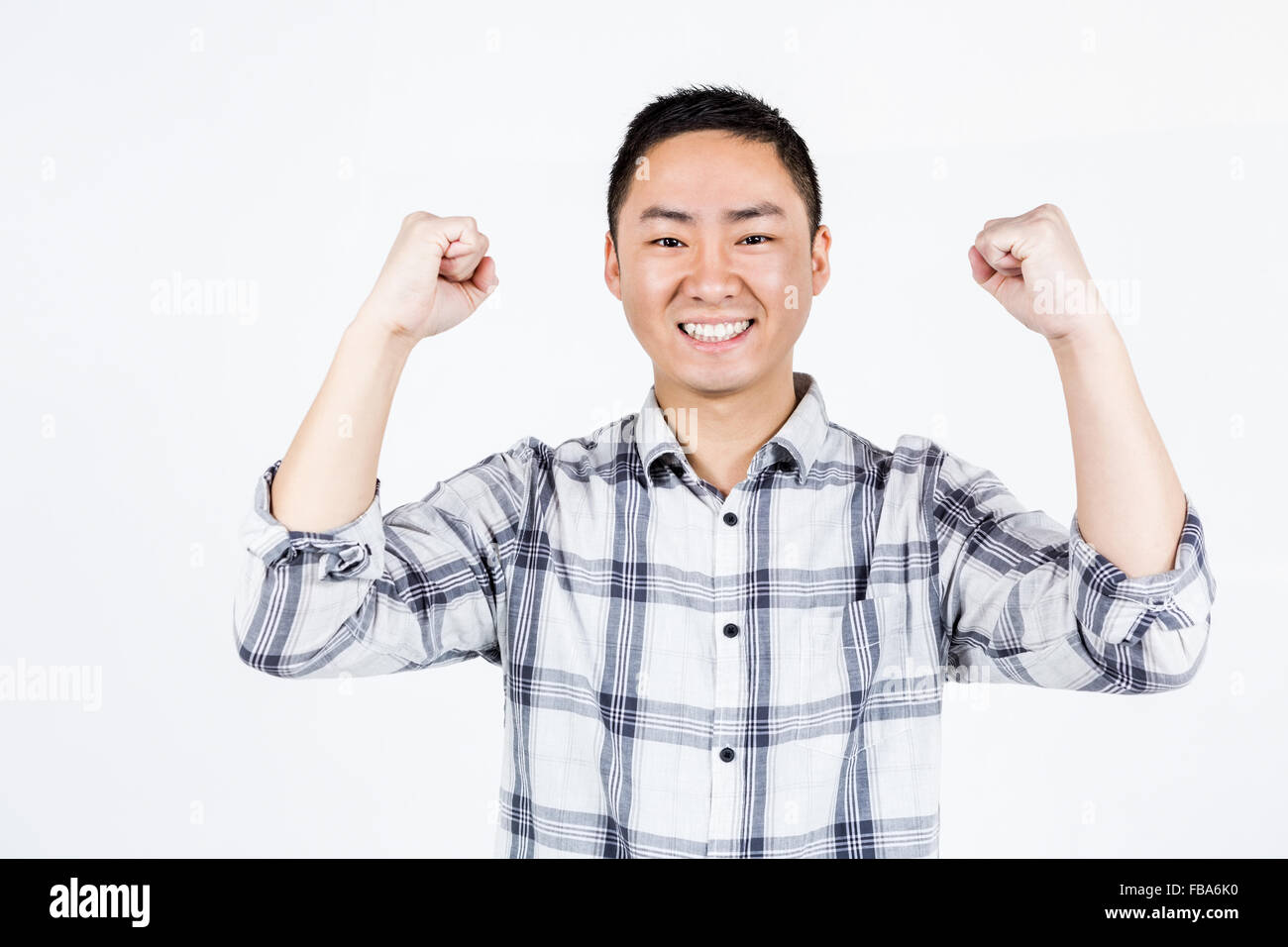 Happy man showing wining gesture - Stock Image