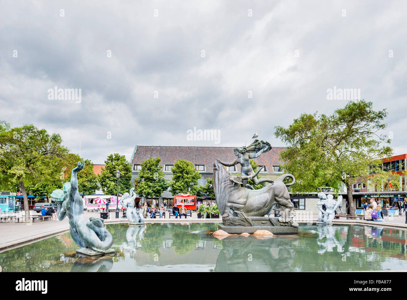 Sweden, Halland, Halmstad, Storatorg, Europa and Bull statue in fountain with buildings in background - Stock Image