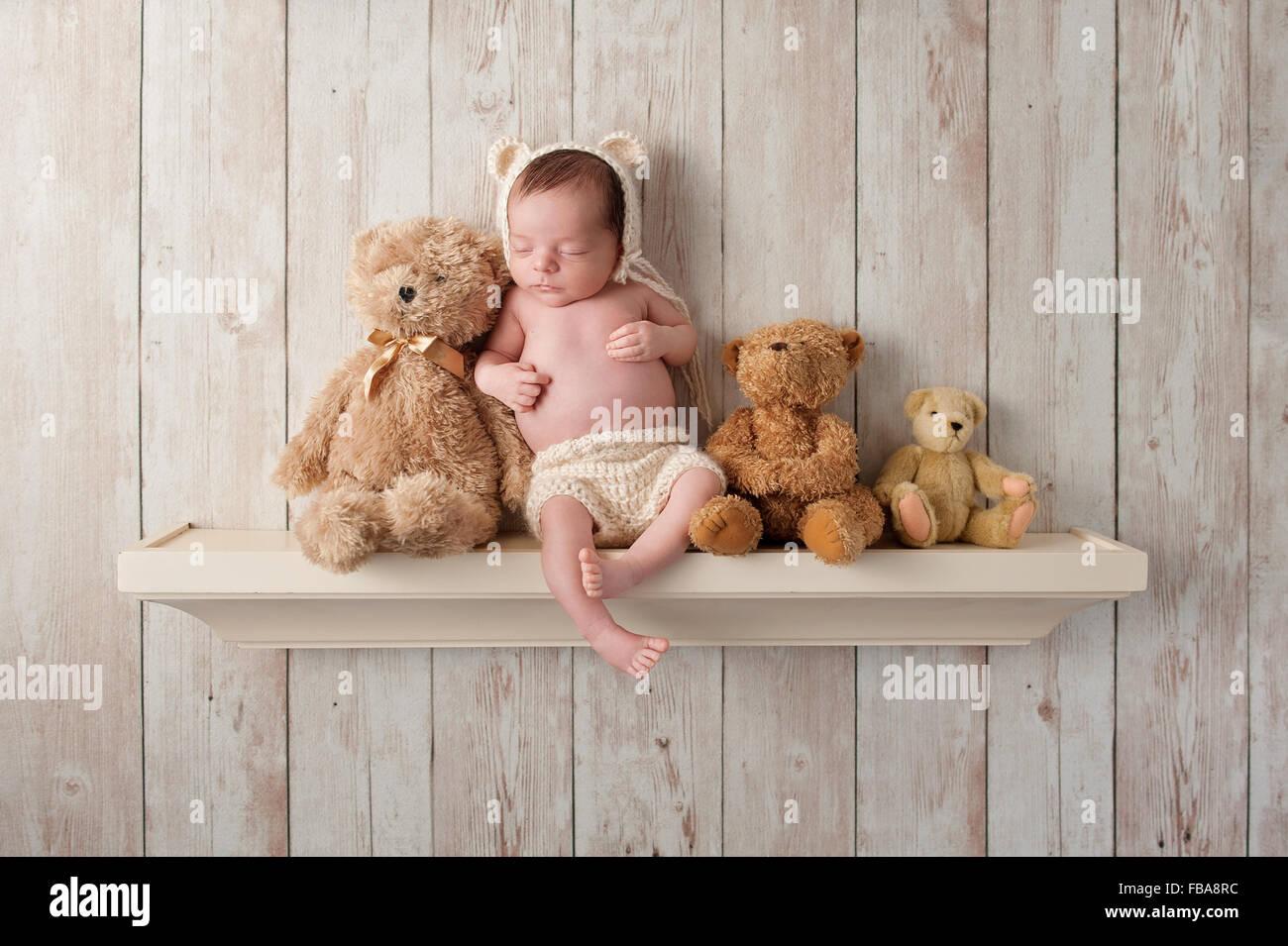Three Week Old Newborn Baby Boy Wearing A Cream Colored Crocheted Bear Bonnet He Is