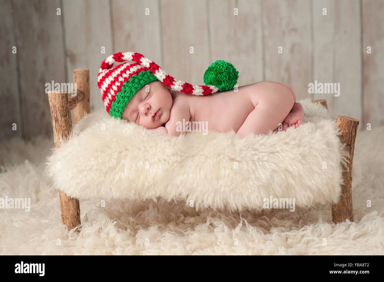 ce5580e0b71 Newborn Baby Boy Wearing a Christmas Elf Hat - Stock Image
