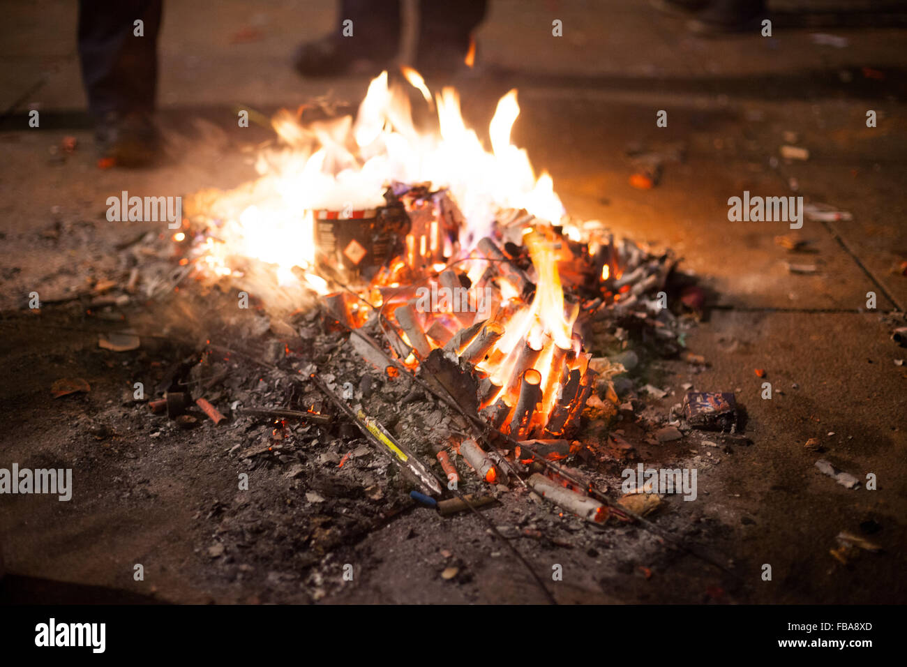 Fire built out of spent fireworks by homeless to keep warm, Berlin New Years Eve 2013 Stock Photo