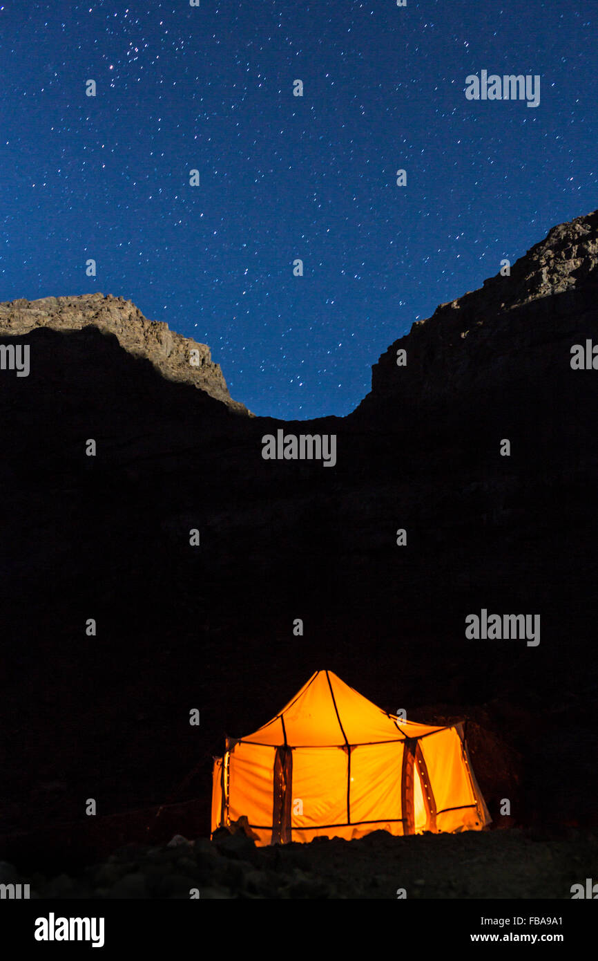 Morocco, Atlas Mountains, Toubkal, Starry sky and illuminated tent - Stock Image