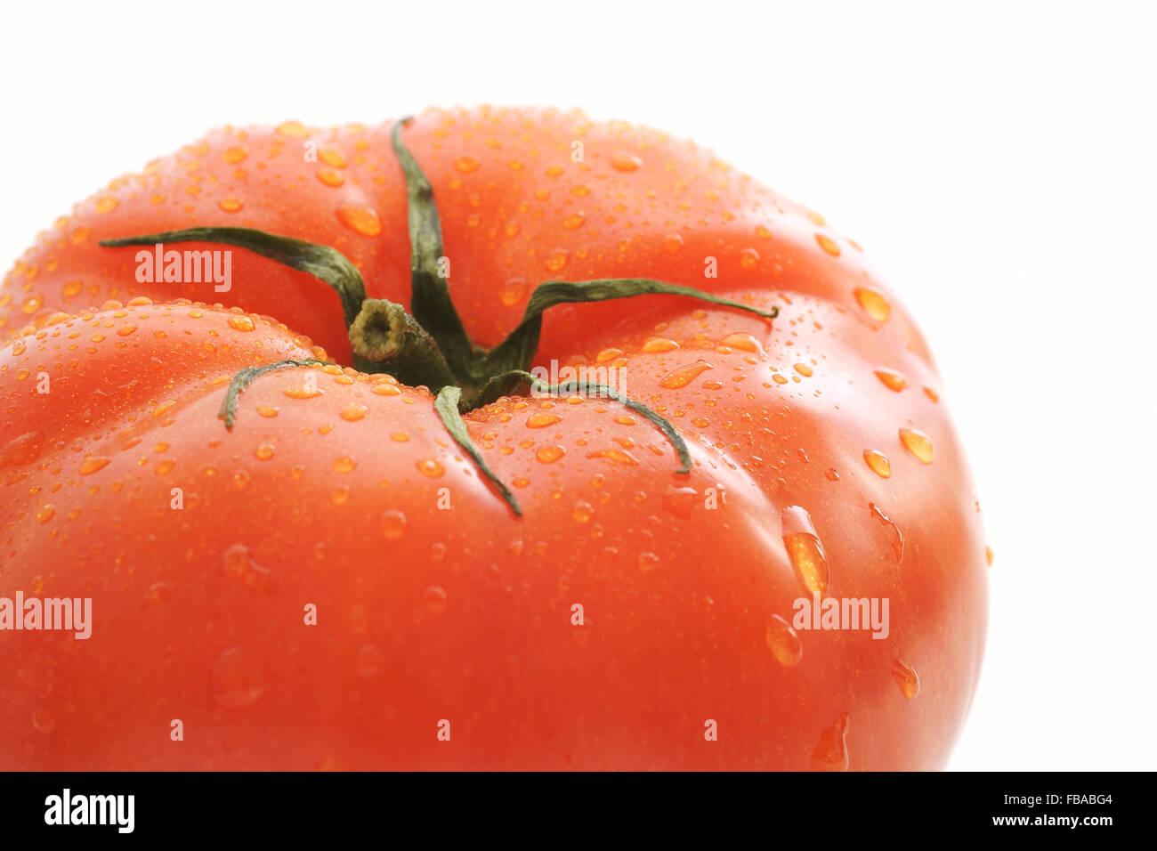 Fresh and plump beefsteak tomato - Stock Image