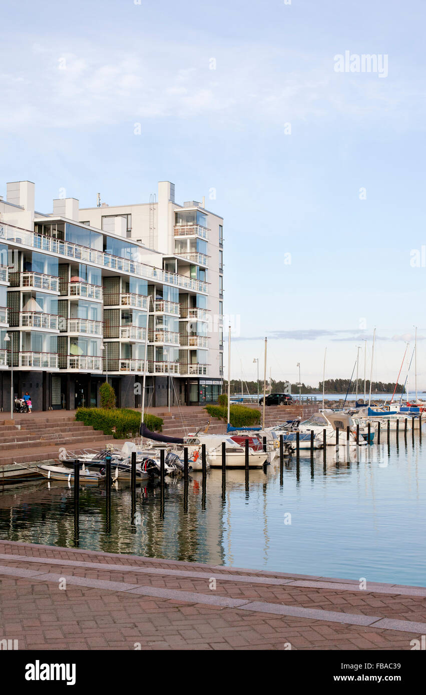 Finland, Uusimaa, Helsinki, Vuosaari, Bay of water with anchored motorboats and residential buildings - Stock Image