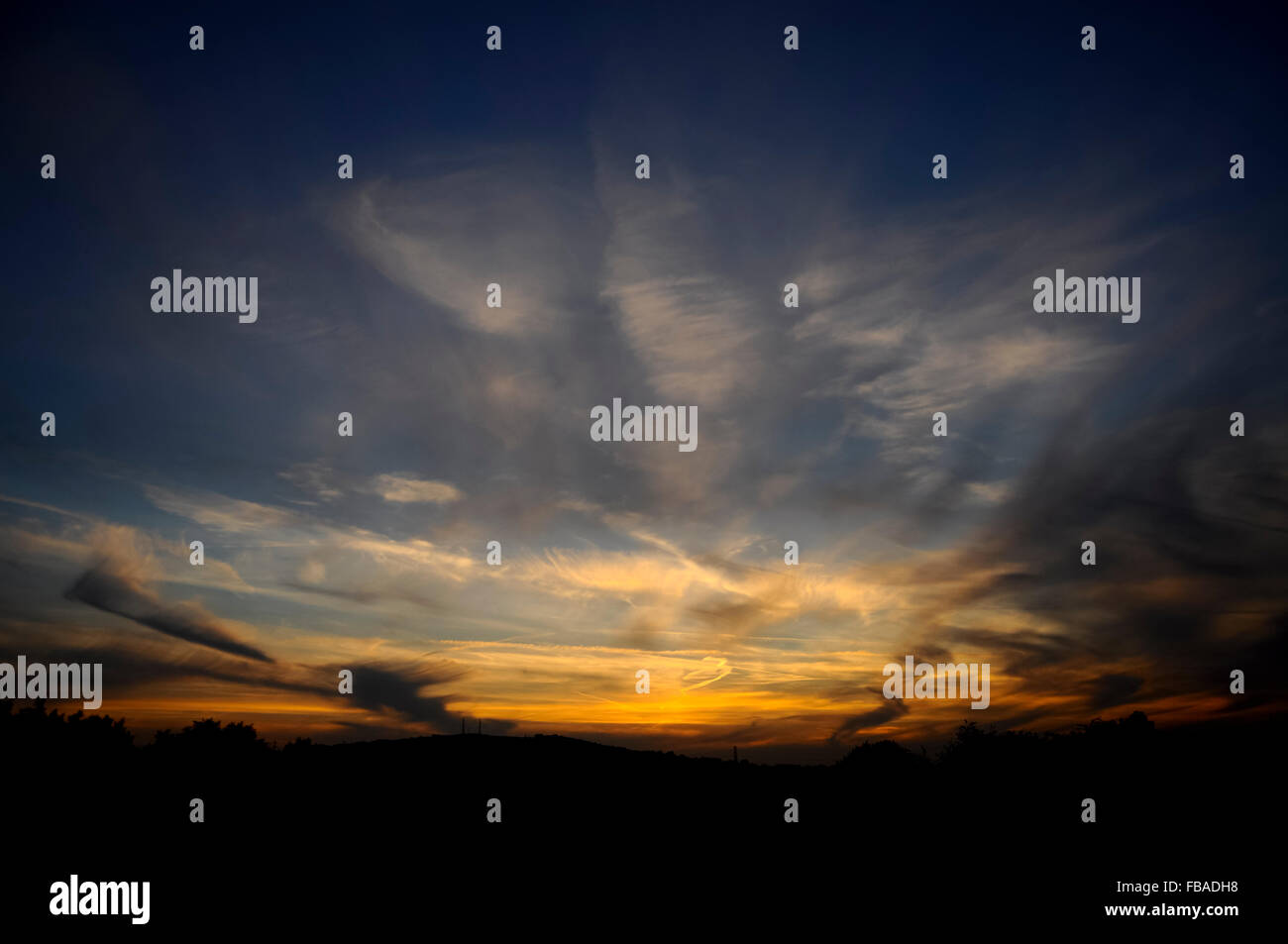 Fading light after a sunset with high wispy clouds in the sky. - Stock Image