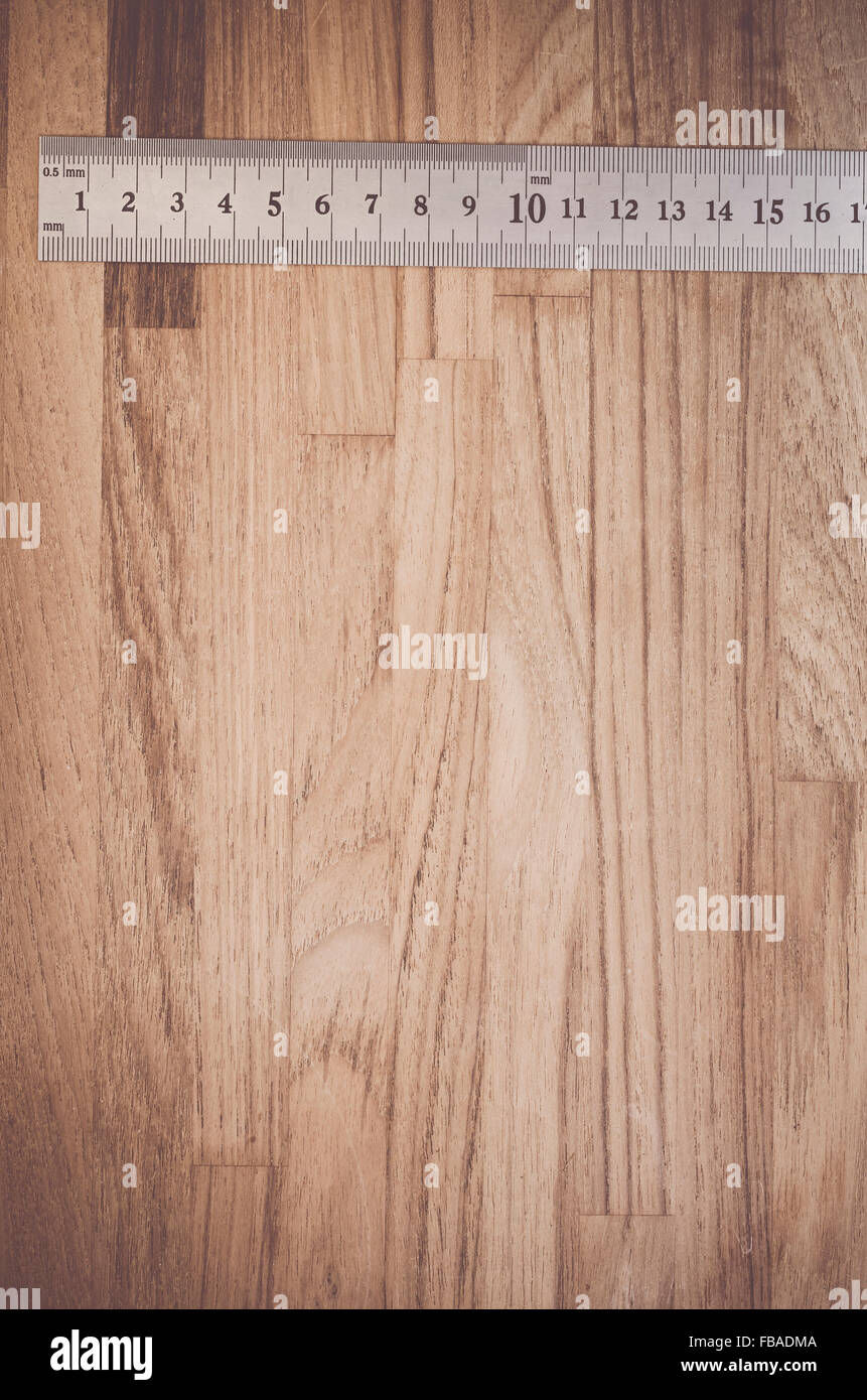 meter, yardstick close up on a wood surface - copy space - Stock Image