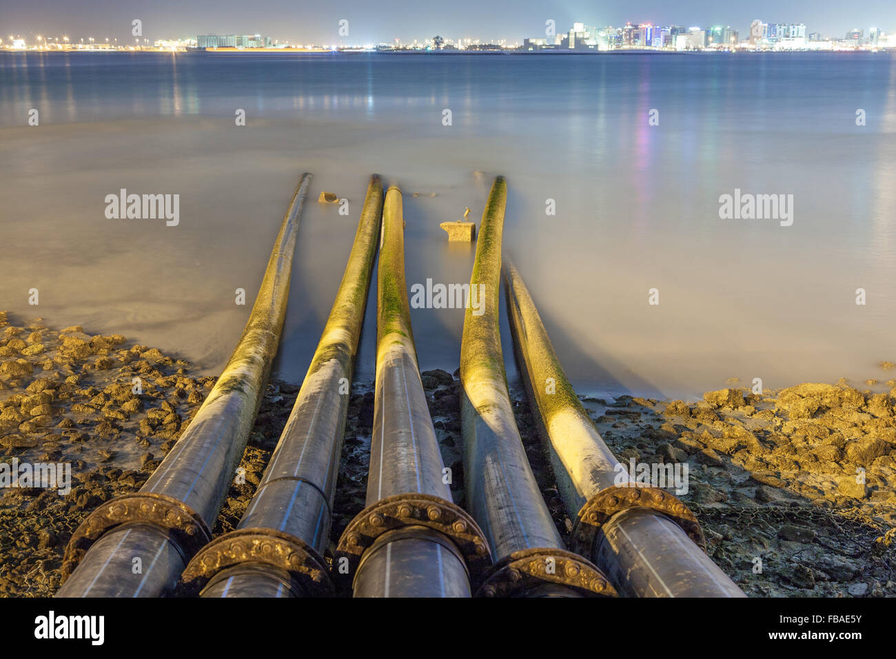 Sewage pipes going into the Persian Gulf in Doha, Qatar, Middle East - Stock Image