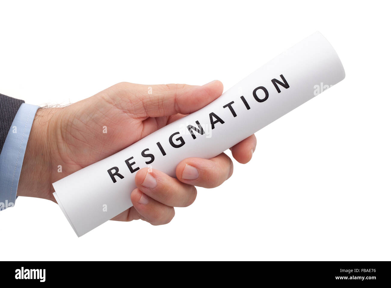 Man in a suit gives a rolled letter of resignation isolated on white background. Image with clipping path. - Stock Image