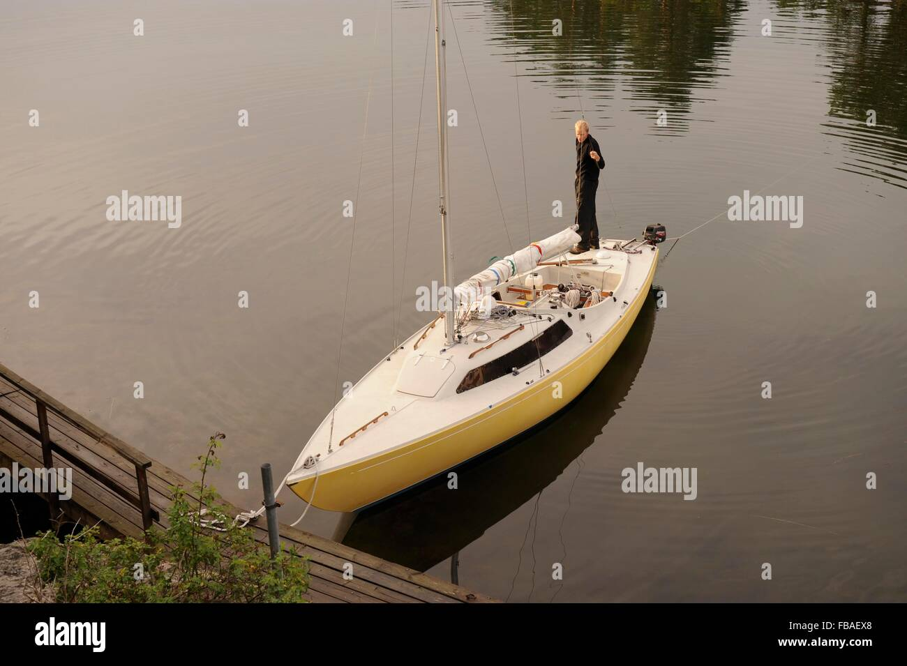 boy on a sailing boat in the Stockholm Archipelago Sweden - Stock Image