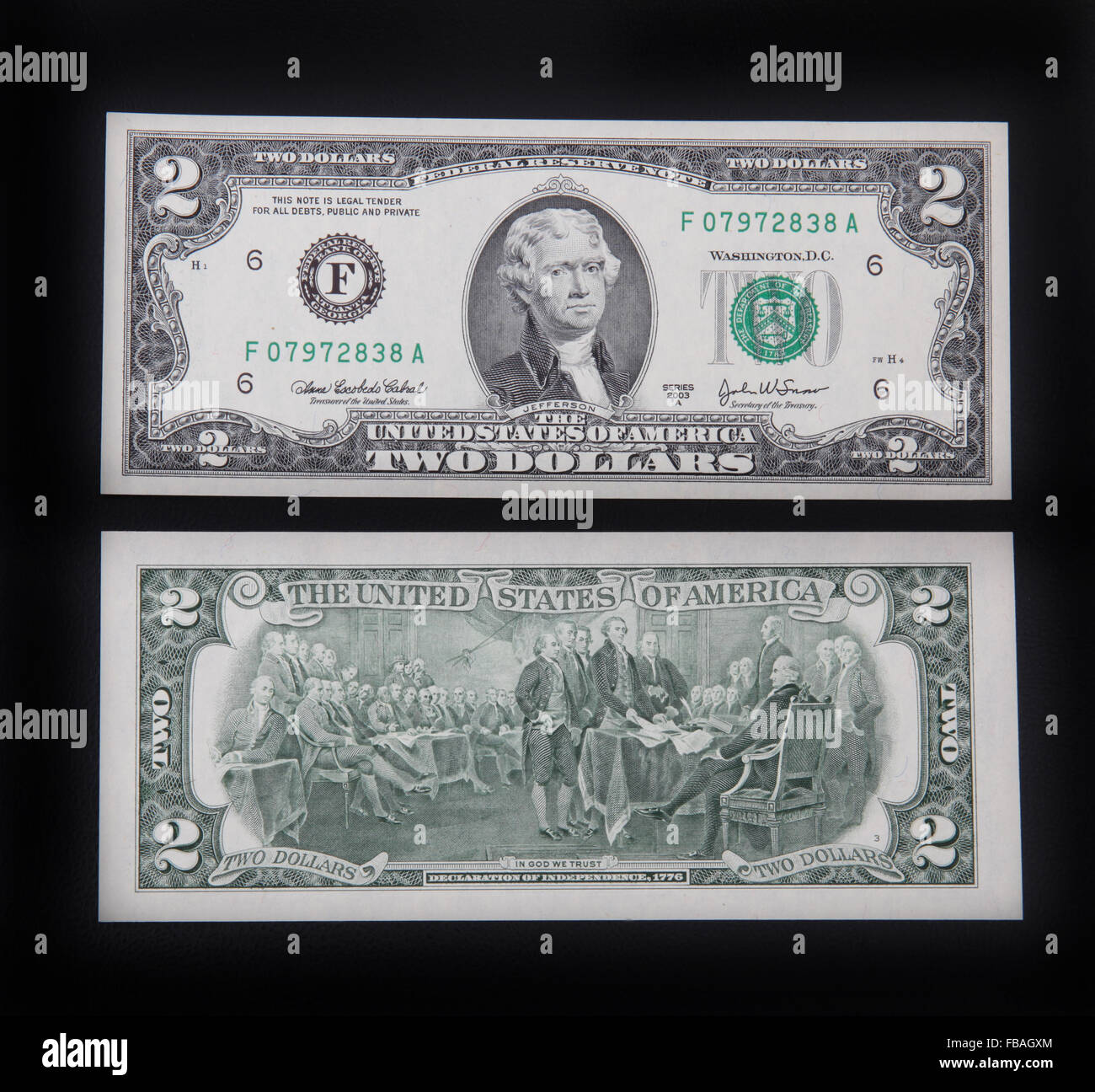 The front and back of a US 2 dollar bill. - Stock Image