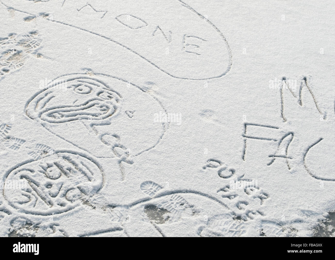 writings and drawings on the snow - Stock Image