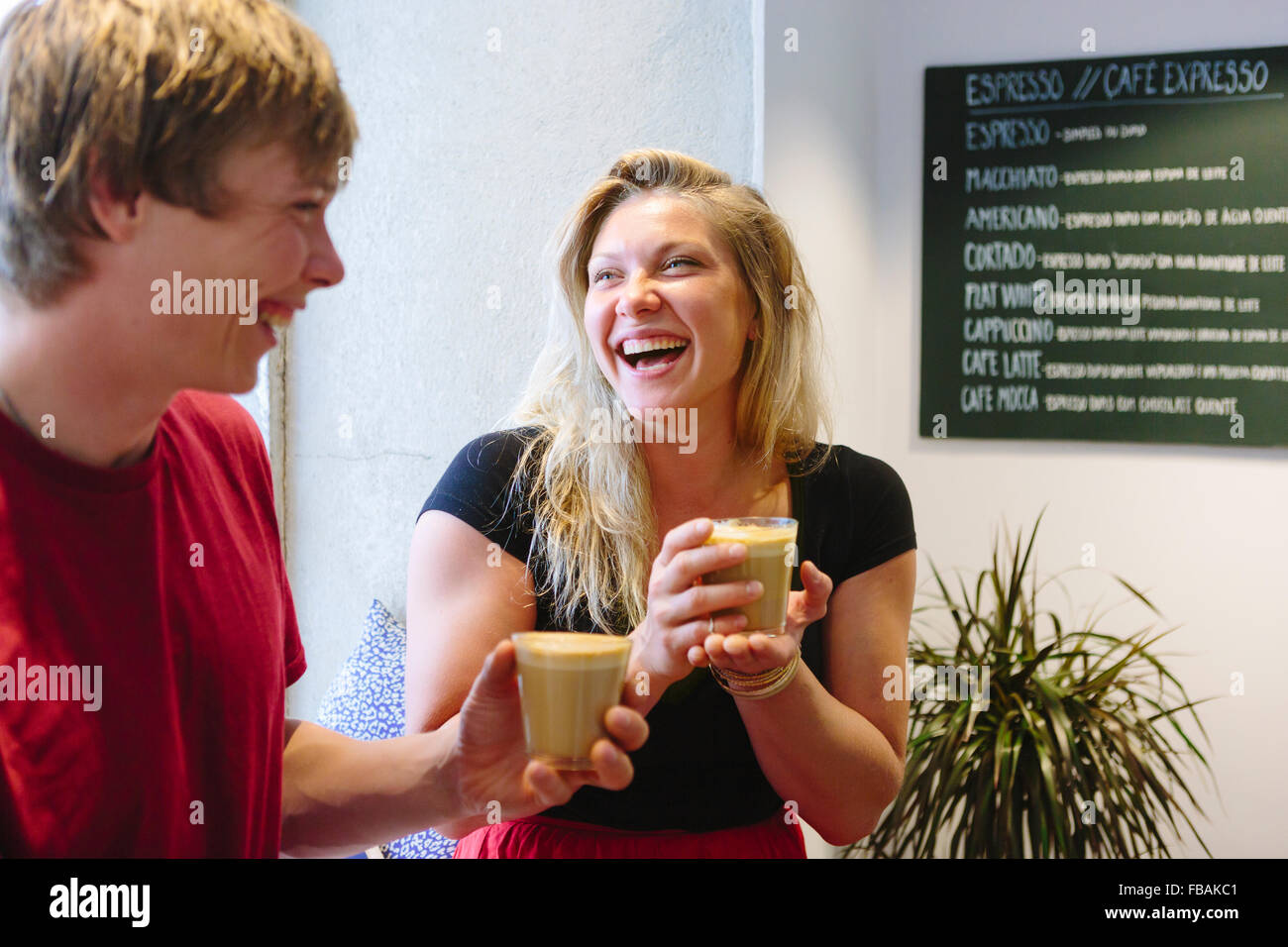 Portugal, Lisbon, Two young people laughing - Stock Image