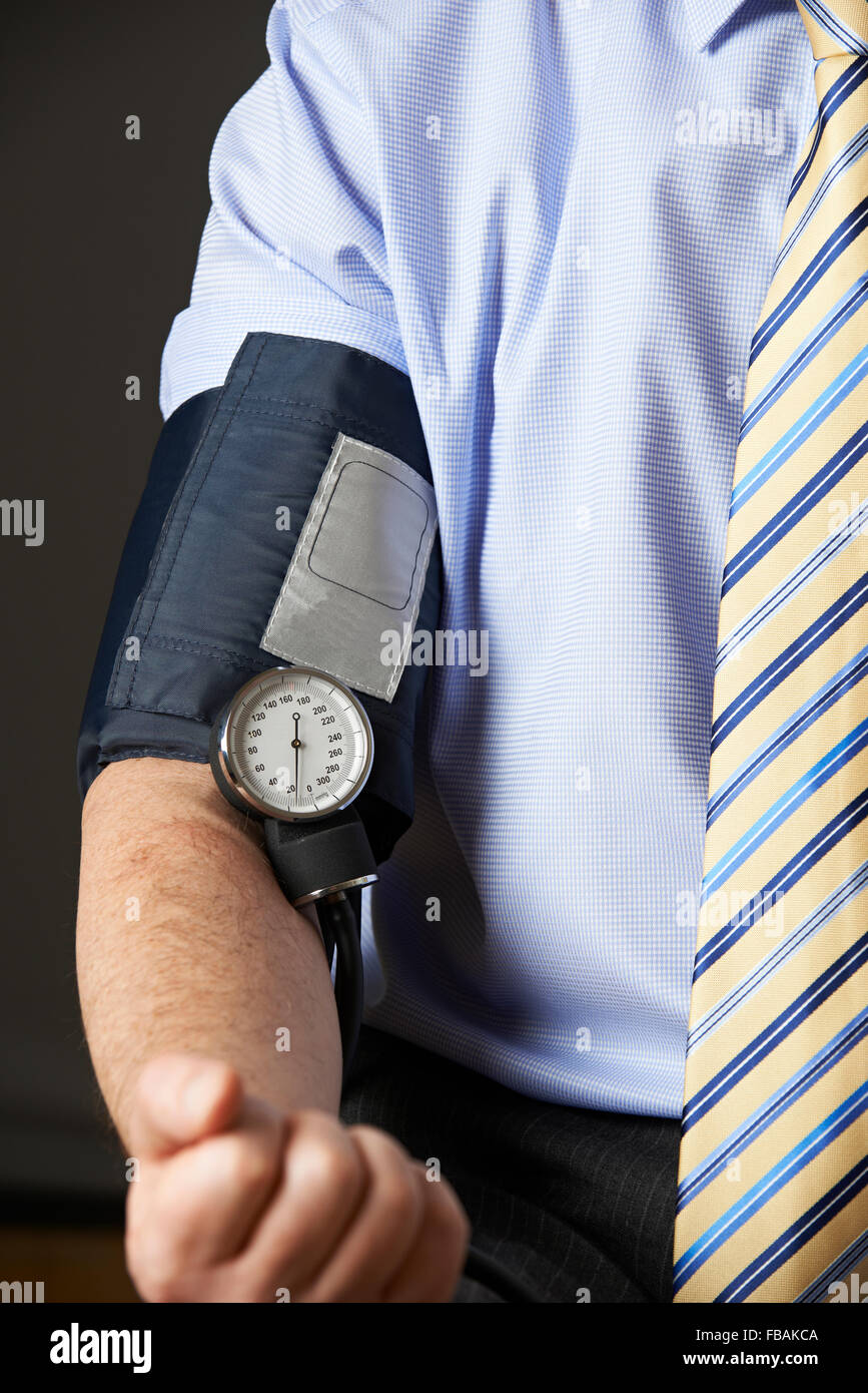 Close Up Of Businessman Having Blood Pressure Checked - Stock Image