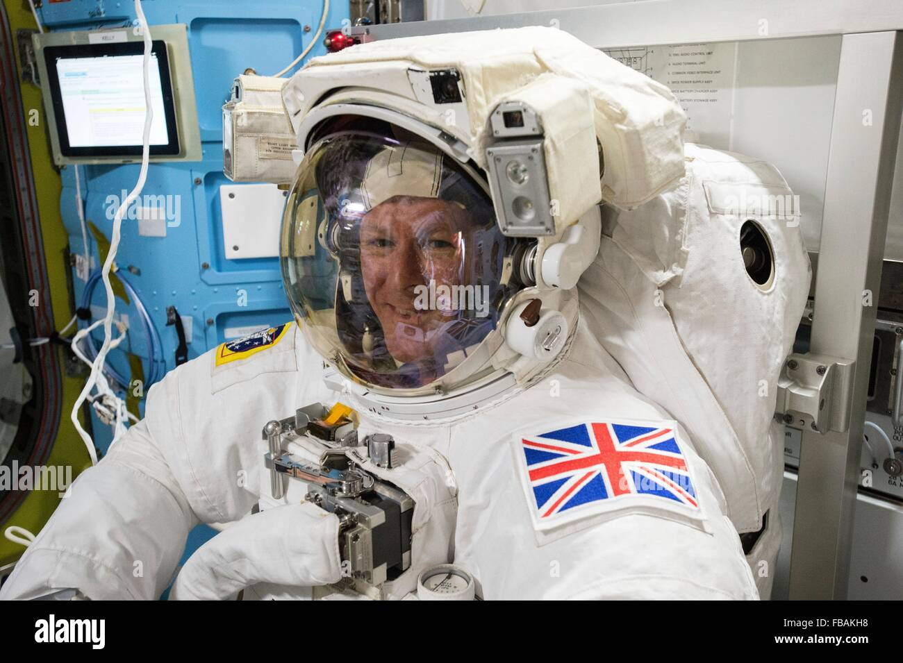 European Space Agency Expedition 46 astronaut Timothy Peake conducts a final fit check inside his spacesuit January - Stock Image