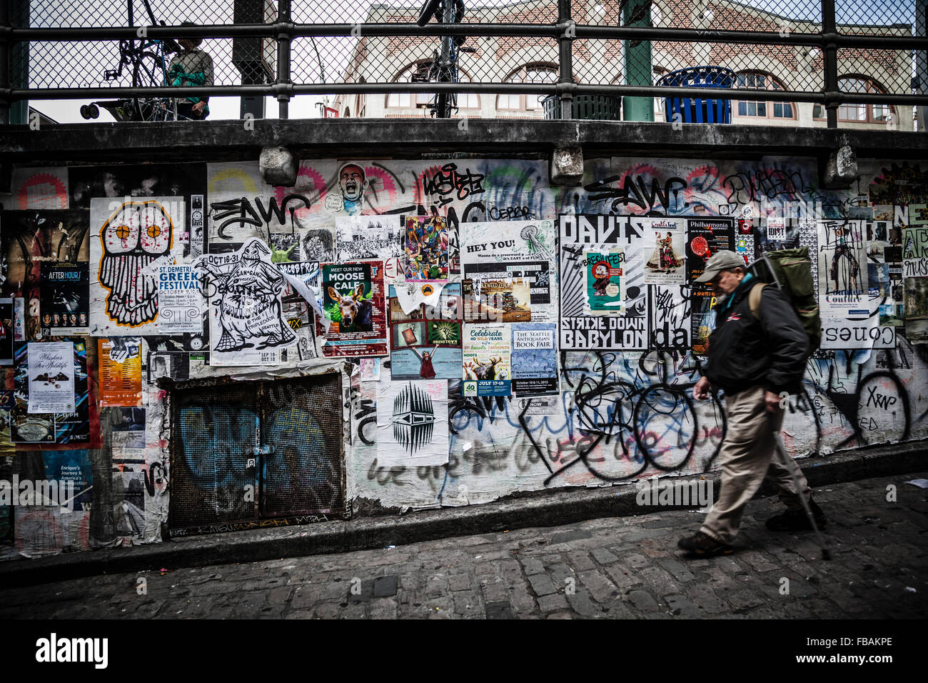 man walking to the post alley under pike place market seattle stock photo 93048102 alamy. Black Bedroom Furniture Sets. Home Design Ideas