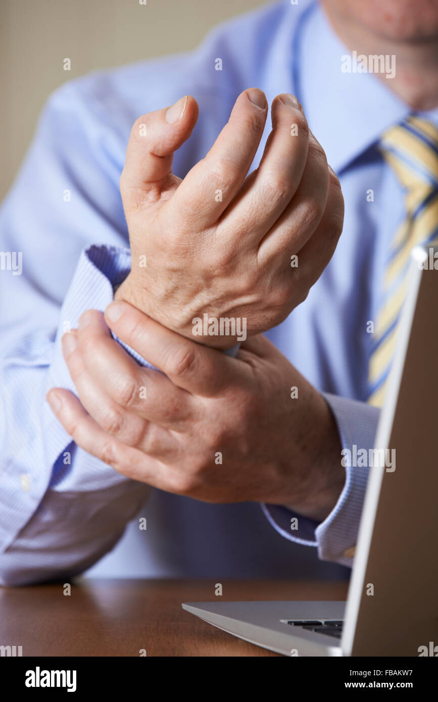 Businessman Suffering From Repetitive Strain Injury (RSI) - Stock Image