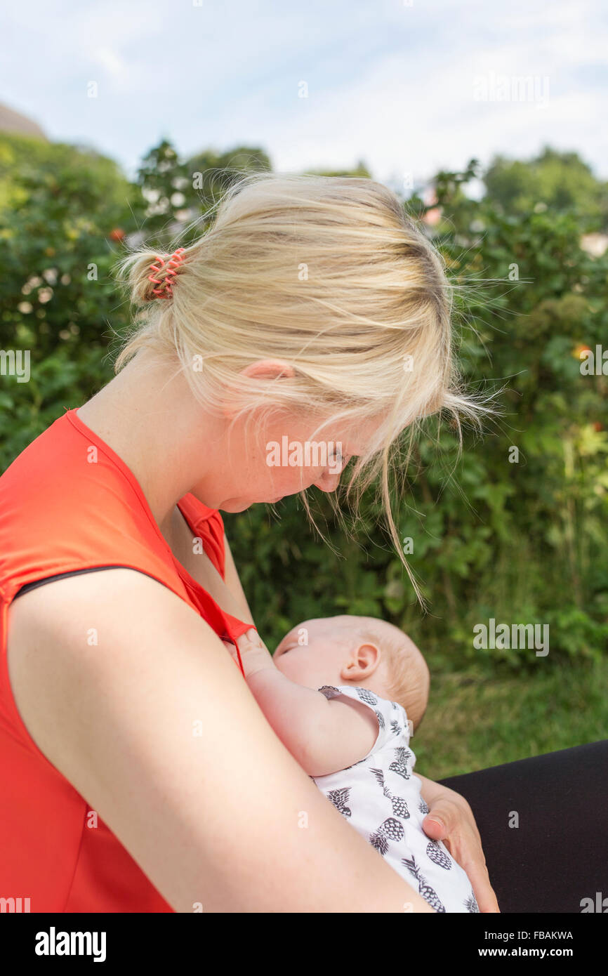 Finland, Mother holding and breastfeeding newborn son (0-1 months) Stock Photo