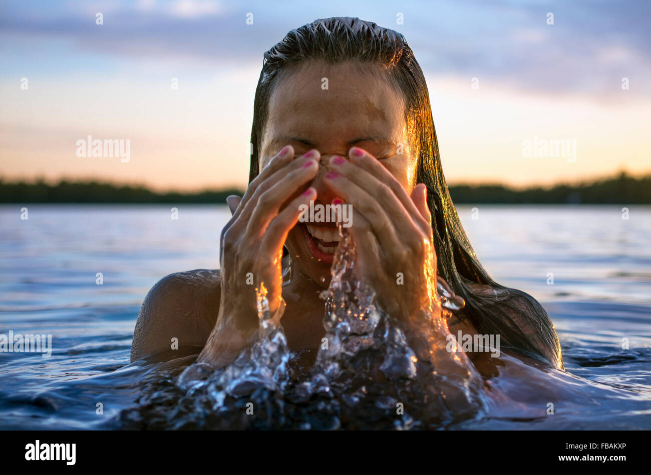 Finland, Pohjanmaa, Luoto, Young woman coming out of water - Stock Image