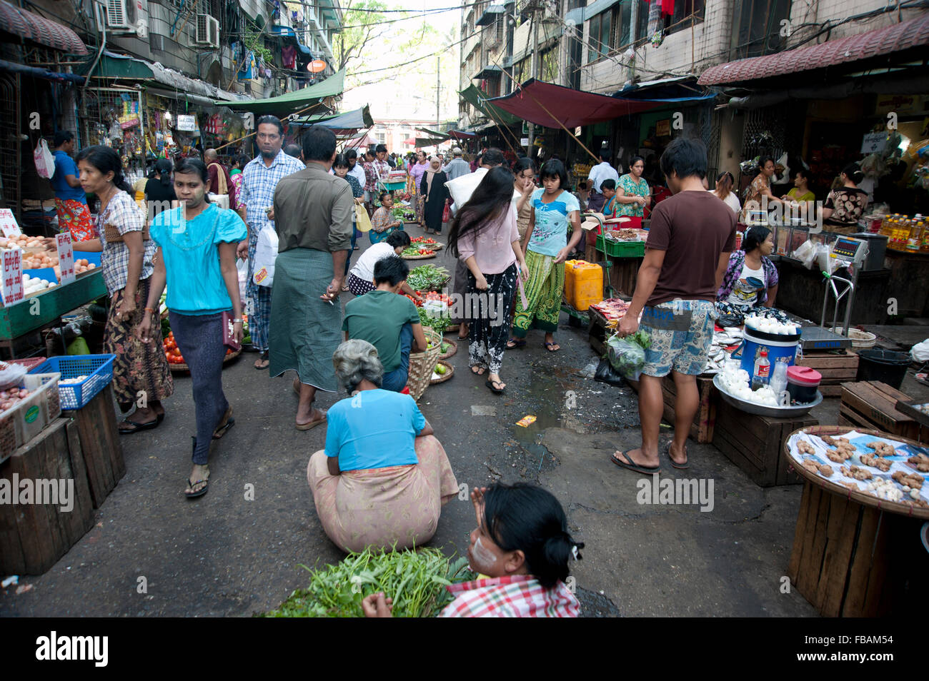 Hindu, Muslim and Buddhist shop side by side on one of Yangon's many fresh food street markets Myanmar - Stock Image