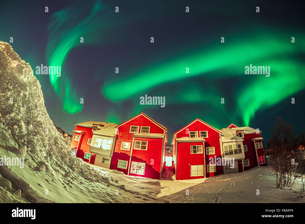 Aurora Borealis over Norwegian houses - Stock Image