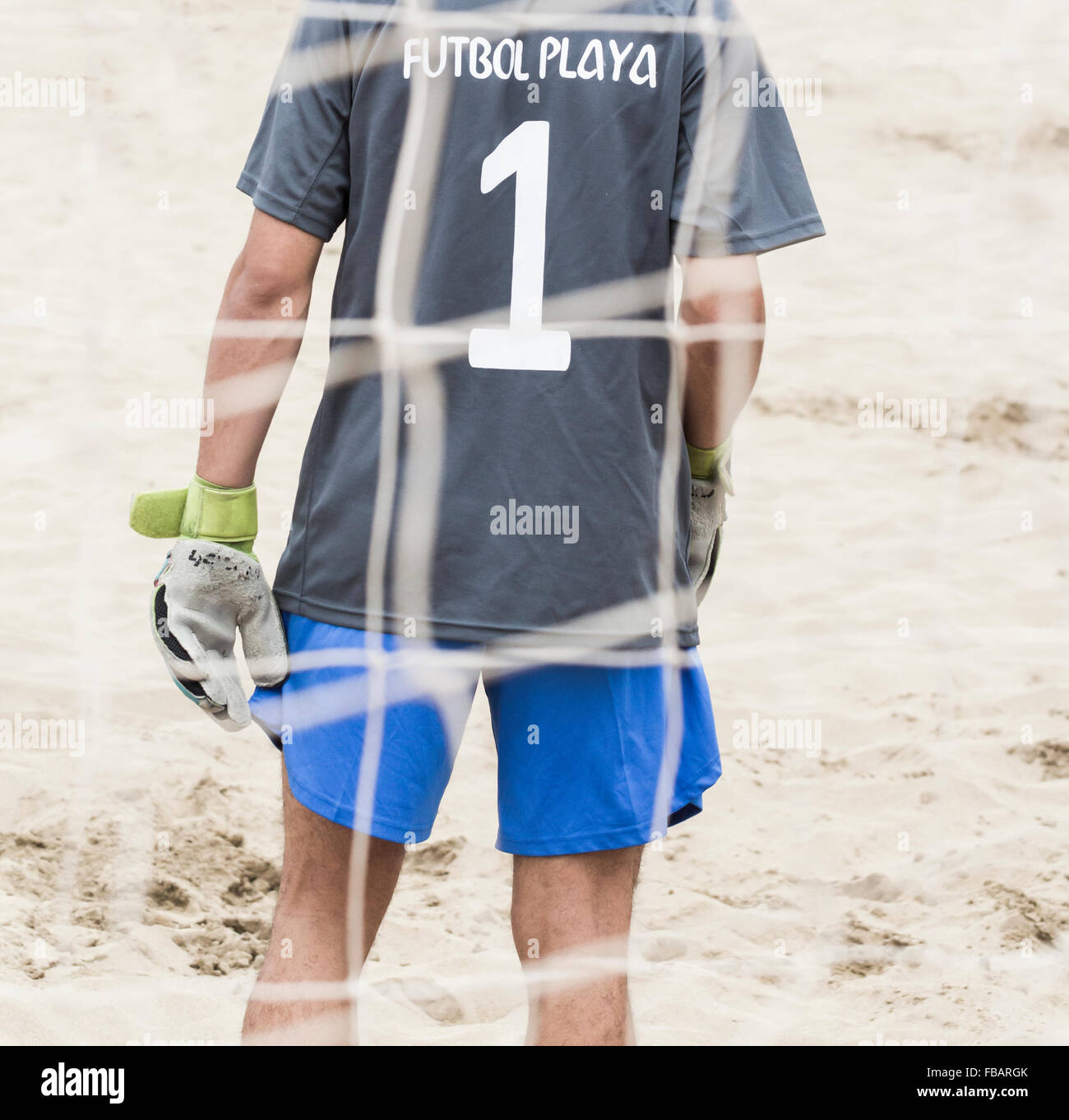 Rear view of goalkeeper at beach football tournament in Spain. Futbol Playa is Spanish for beach football - Stock Image