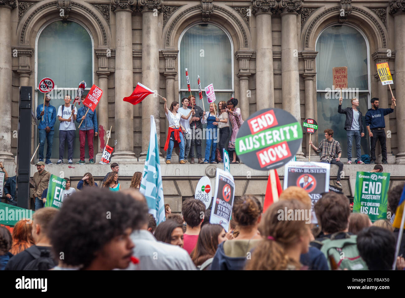 Students protesting & enjoying themselves at London Anti-Austerity Rally - Stock Image