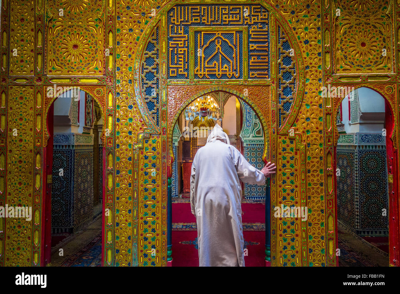 Man entering a mosque, Morocco - Stock Image