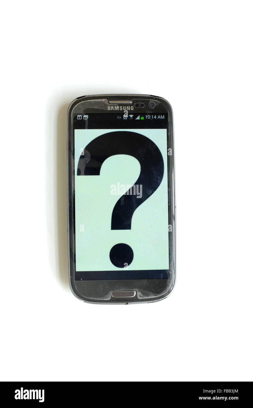 A question mark on a smartphone screen photographed against a white background. - Stock Image