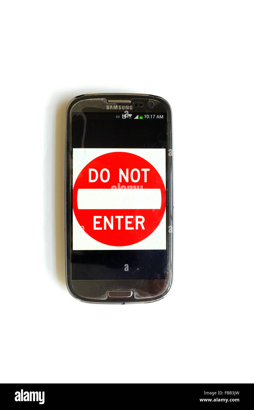 A No Entry sign on a smartphone screen photographed against a white background. - Stock Image
