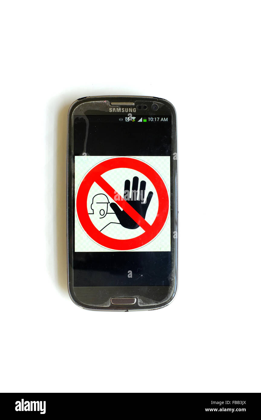 A no entry image on a smartphone screen photographed against a white background. - Stock Image