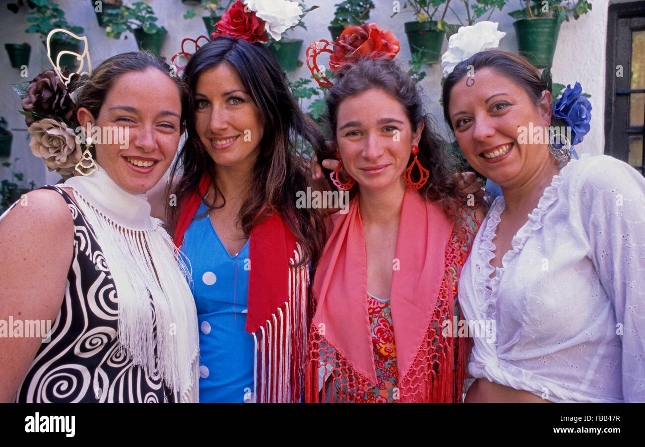 Córdoba.Andalusia. Spain: Portrait of women wearing traditional suit during the May Fair - Stock Image