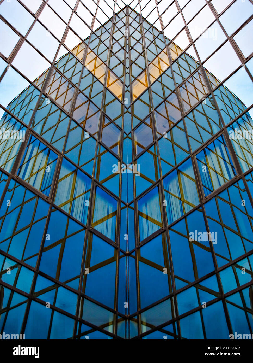 Glass walls of business center with reflections - Stock Image