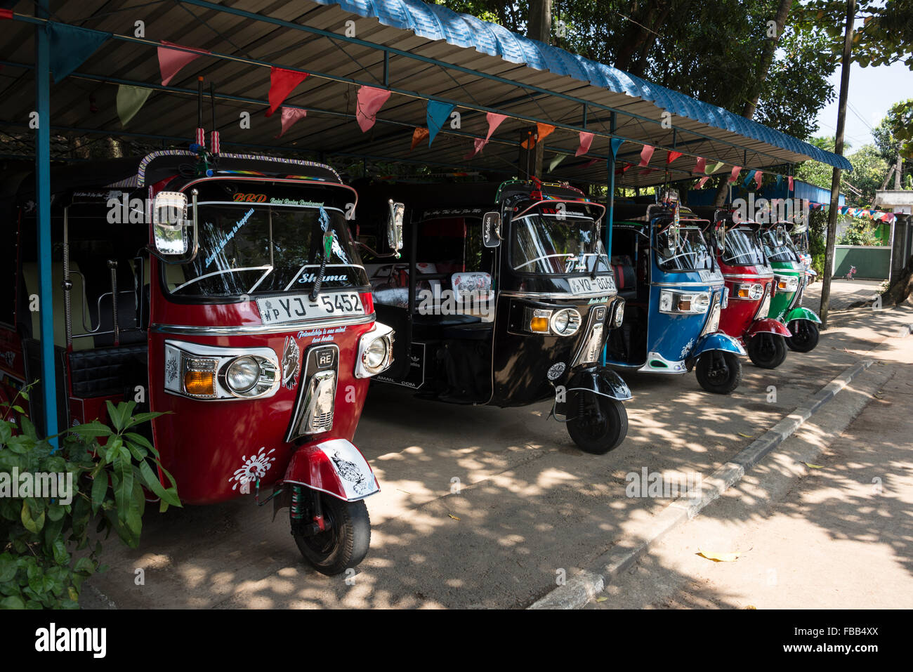 A row of 2nd hand three wheelers as they are known in sri lanka on