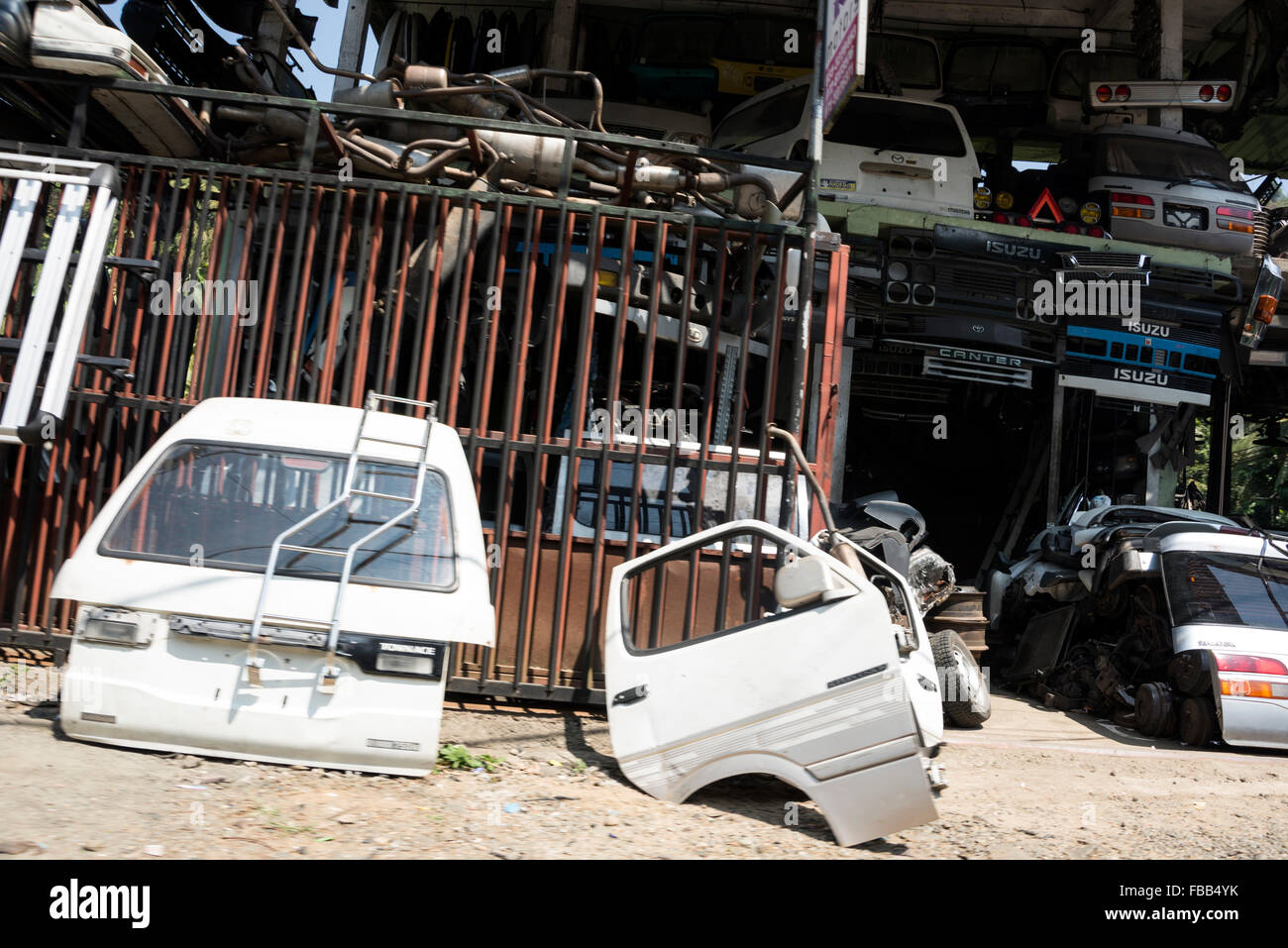 A number of small secondhand car parts shops on the A1 highway (Colombo-Kandy Highway in Sri Lanka. - Stock Image