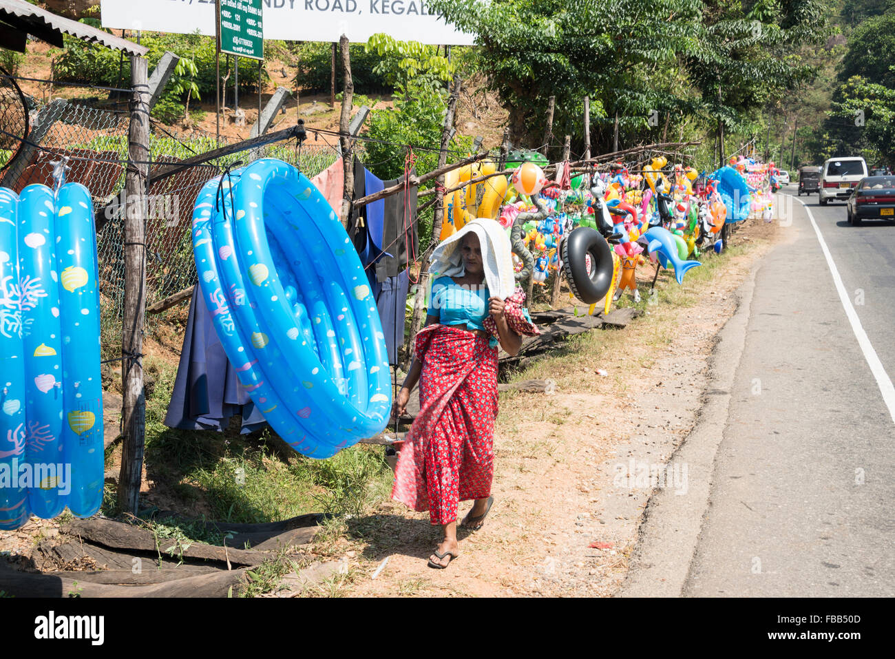 A long row of small businesses selling colourful toys beside the  A1 highway (Colombo-Kandy Highway ) in Sri Lanka. Stock Photo