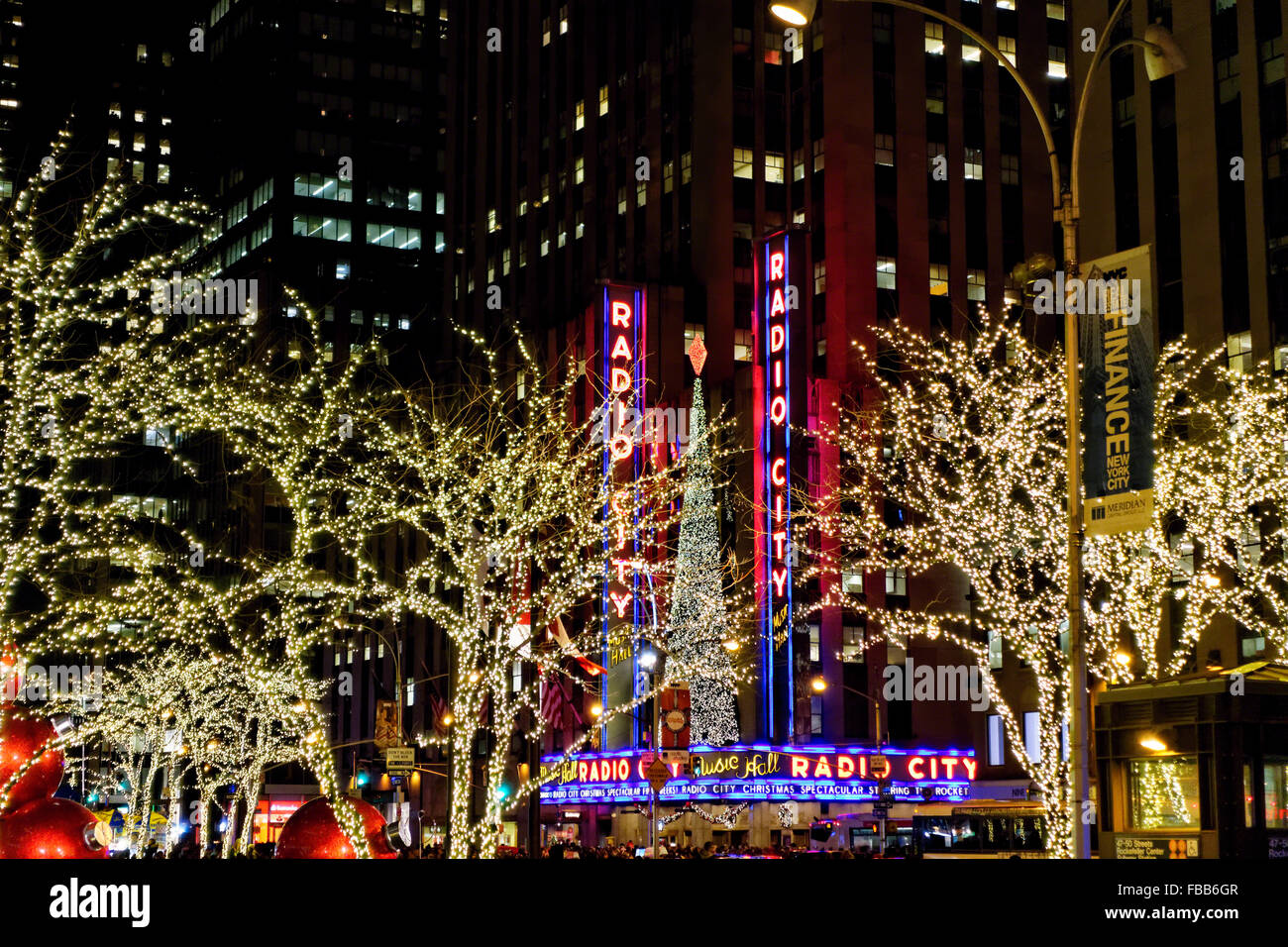 Low Angle View of the Radio City Music Hall Lit Up at Night During the Winter Holiday Season, Manhattan, New York Stock Photo