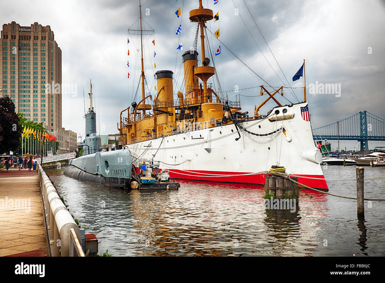 View of The Olympia Warship and the Becuna Submarine Docked at The Independence Seaport Museum, Philadelphia, Pennsylvania - Stock Image