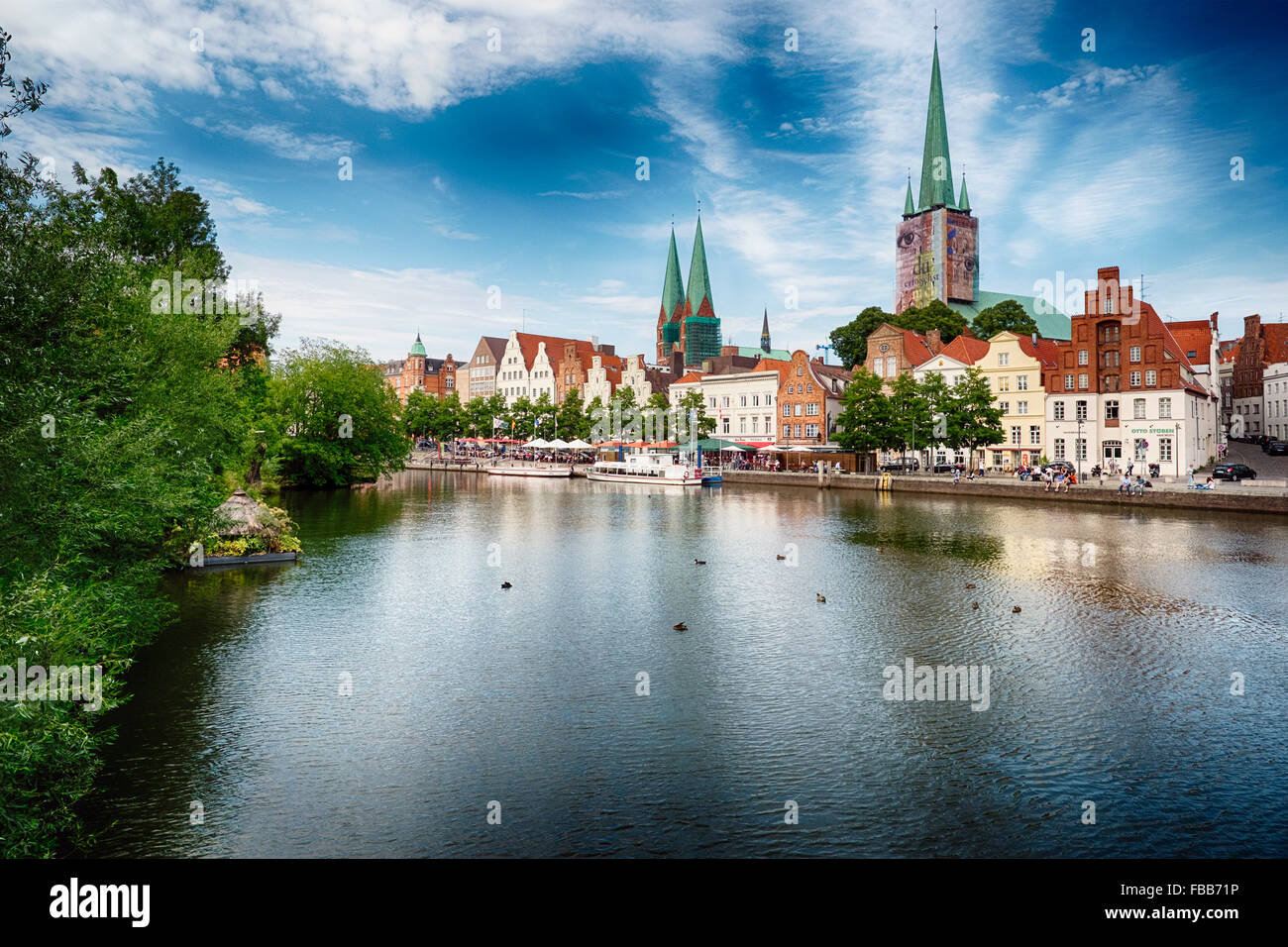 View of the Waterfront of Old Town Lubeck with the Trave Canal, Schleswig-Holstein, Germany - Stock Image