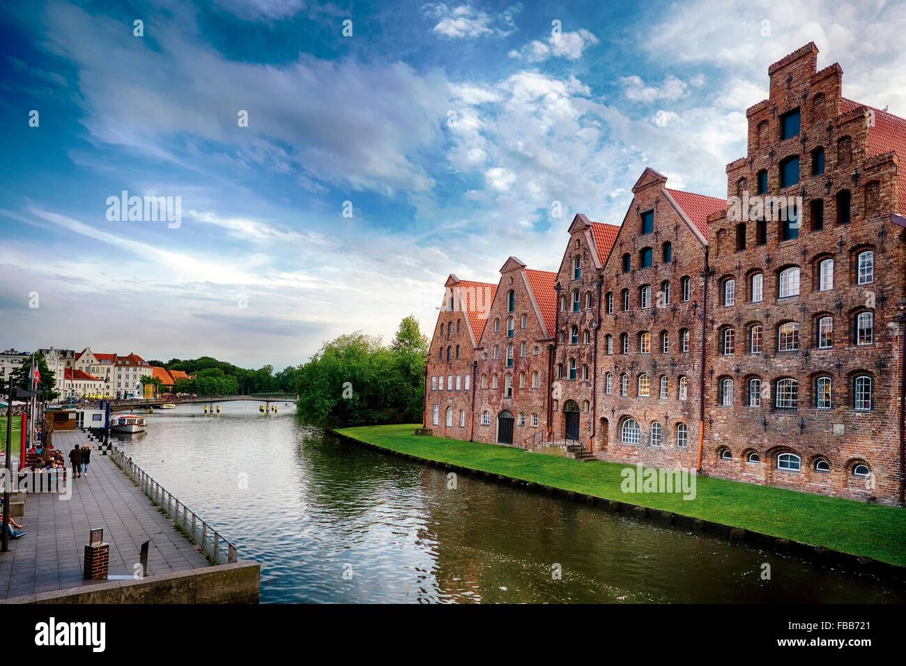 Low Angle View of Old Brick Crow-Stepped Gable Warehouse Buildings Along a Canal, Old Town Lubeck, Schleswig-Holstein, - Stock Image