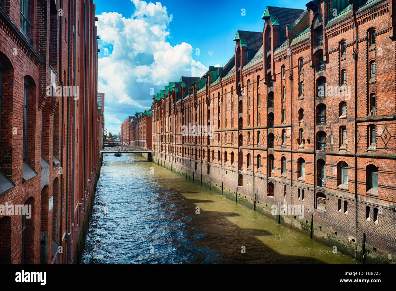 View of a Row of Red Brick Warehouses along a Canal, Speicherstadt, Hamburg, Germany - Stock Image