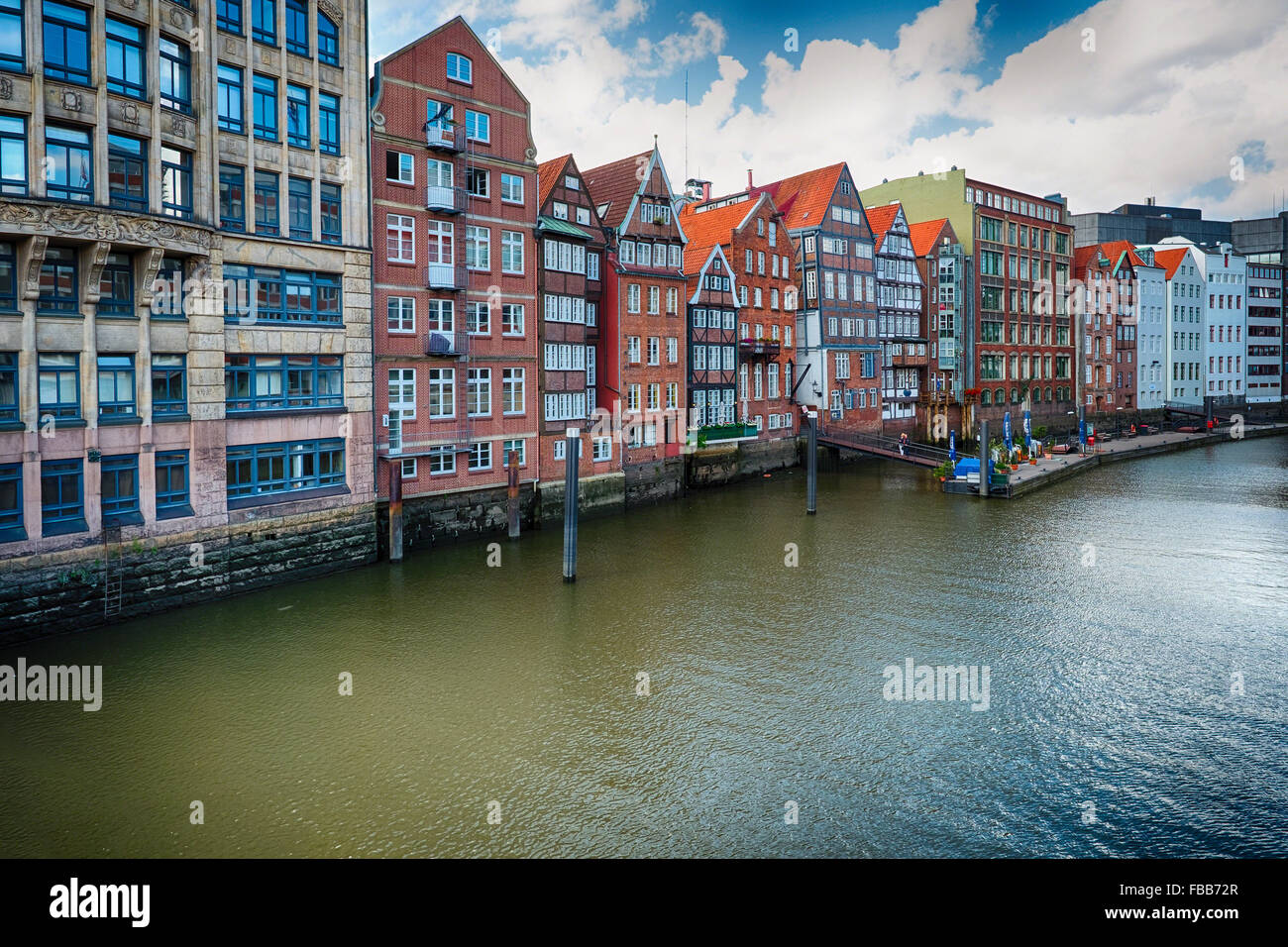 Colorful Row Houses in Old Town Hamburg Along a Canal, Viewed from the High Bridge, Hamburg, Germany - Stock Image