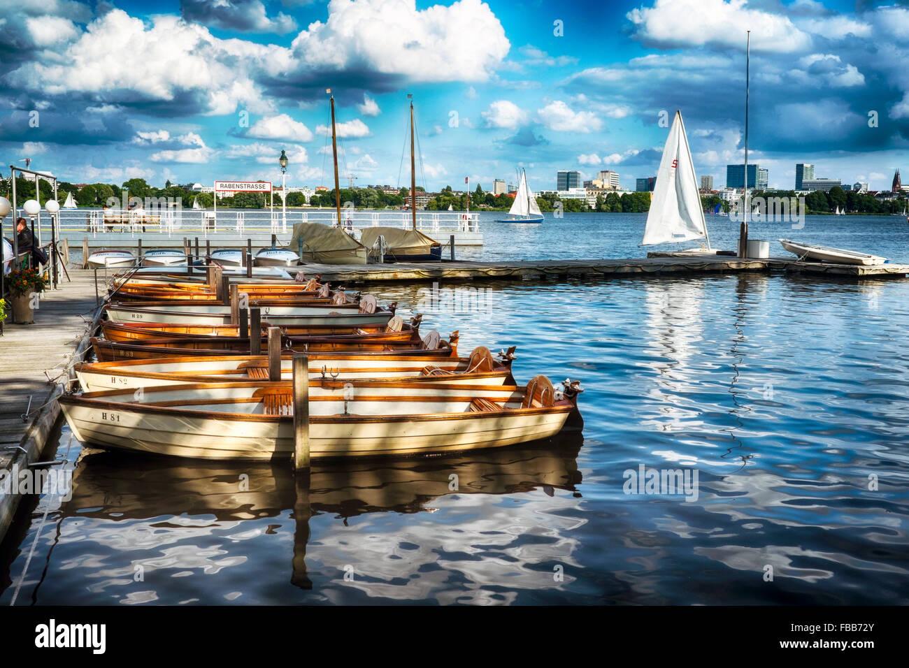 Small Boats at a Pier, Alster Lake, Rabenstrasse, Hamburg, Germany - Stock Image
