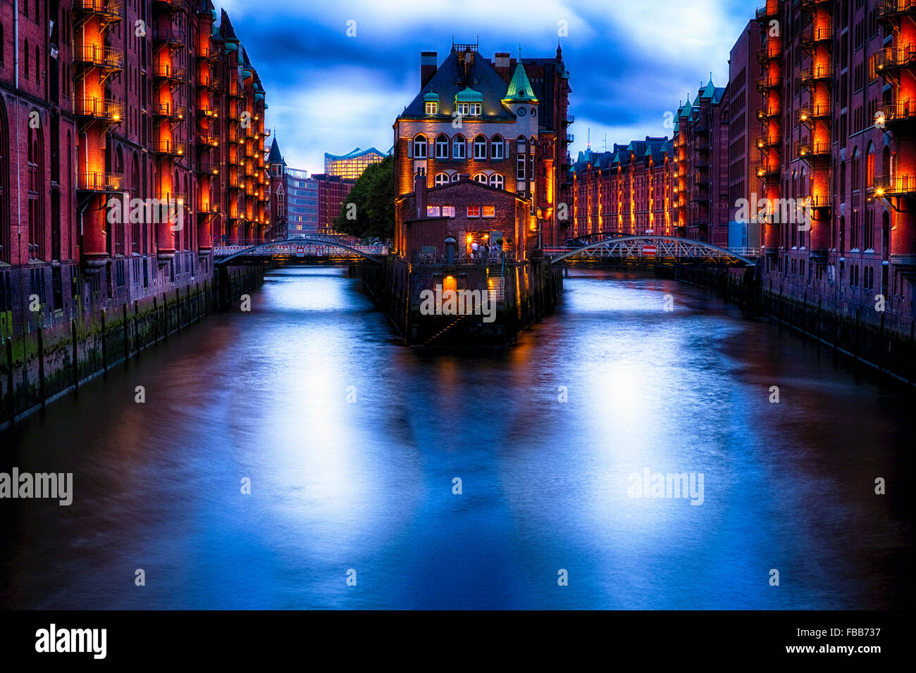 Water Castle Illuminated at Night in the Warehouse District in Hafen City, Hamburg, Germany - Stock Image